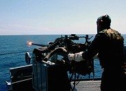 Seaman fires a Mark 38 MK_38 25 mm machine gun system
