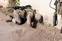 Combat engineer searches for possible improvised explosive devices and weapons