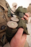 A Marine cradles handfuls of 40 mm grenades during a training exercise
