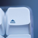 Close up of eject key on computer keyboard