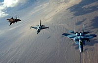 F_15 Eagles and F_16 Fighting Falcon head to the fight after refueling