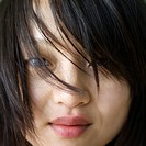Close up portrait of pretty young Asian woman