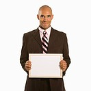 African American man holding blank sign standing against white background