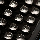 Close up of type levers on typewriter keyboard