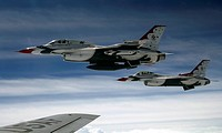 U.S. Air Force F_16 aircraft fly off the wing of a KC_135 Stratotanker