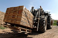Senior Airman loads a pallet of ammunition onto a truck for delivery