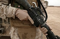 Marine displays the required hand personal protective equipment