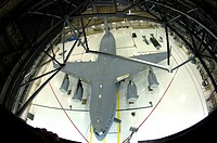 A C_17 Globemaster III sits in the hangar after being pressure washed