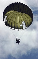 Paratrooper wearing an MC1_C parachute descends after jumping