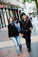 Young couple walking on New Street, Birmingham, England, UK