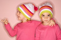 Young female twin Caucasian children standing together