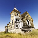 Scenic of old abandoned church in field