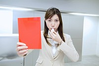 The Business Woman Who Takes Out A Red Card