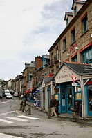 street scene by the port in Cancale, Brittany, France