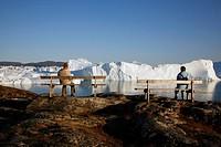 People watching the Ilulissat Kangerlua Glacier also known as Sermeq Kujalleq, Ilulissat, Disko Bay, Greenland
