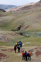 Hikers walking in the mountains in the area of Qassiarsuk, South Greenland