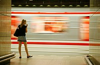 young woman at the Metro station, Prague, Czech Republic