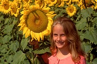 Pretty girl in a field of sunflowers