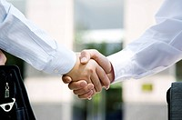 Close_up of two business men shaking hands