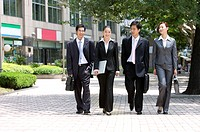 Four business people walking on the street