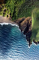 Aerial of cliff on Maui, Hawaii coast with beach