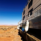 Landscape of houseboat sitting in the middle of the desert in rural Arizona, United States