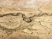 Aerial of Colorado desert landscape with dried riverbed.