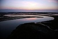 Tidal creek meandering through wetlands of Bald Head Island, North Carolina