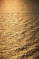 Sun reflecting golden on Atlantic ocean