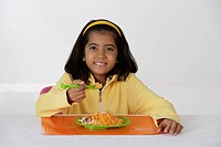 Girl eating briyani rice