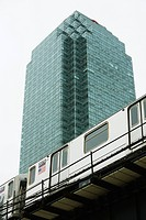Elevated subway, office building in background, low angle view