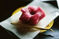 Single pink wagashi on plate