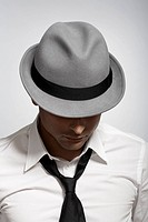 Mid adult man wearing fedora (thumbnail)