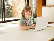 Boy using laptop computer portrait