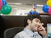 Office worker wearing party hat