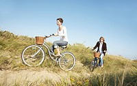 Couple cycling in field