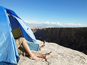 Couple sleeping in tent by cliff, Moab, Utah, USA