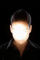 Woman's face in spotlight