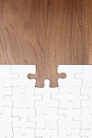 Jigsaw puzzle on wooden background, piece missing