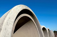 Pre_cast concrete pipes on a side of a motorway