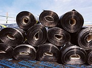Rolls of insulation material on roof