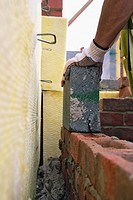 Bricklayer building a cavity wall