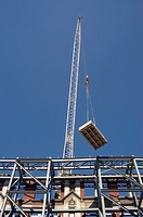 Facade Retention. Crane lifting construction material (thumbnail)