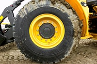 Muddy tyre on a digger