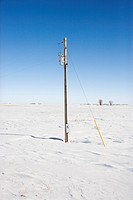 Power line in desolate snow covered rural landscape