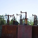 Old rusted metal machinery silhouetted against sky