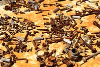 Multiple old rusty nails and screws
