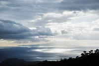 View of island in Pacific ocean with clouds from Maui, Hawaii