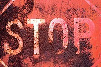 Closeup of rusty old stop sign