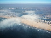 Aerial view of clouds covering beachfront in Southern California